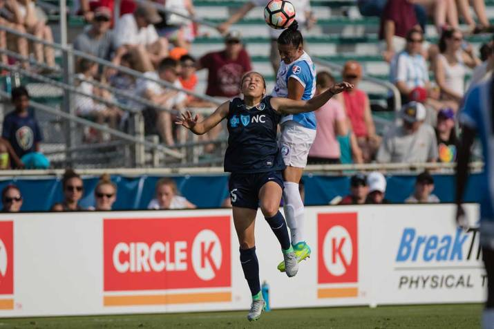 Ali Krieger wins the aerial duel with Jaelene Hinkle. (Shane Lardinois)