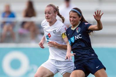 Becky Sauerbrunn and Ashley Hatch battling for position. (Shane Lardinois)