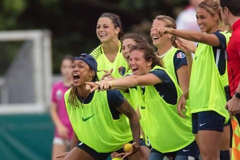 The Courage celebrating Kristen Hamilton's goal on the sideline. (Shane Lardinois)