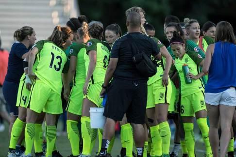Seattle Reign FC huddle. (Shane Lardinois)
