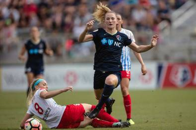 Sam Mewis maneuvers past Julie Ertz. (Shane Lardinois)