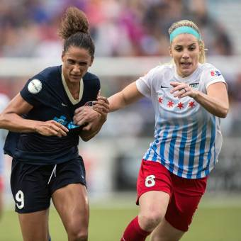 Lynn Williams not really feeling the shirt grab by Julie Ertz. (Shane Lardinois)