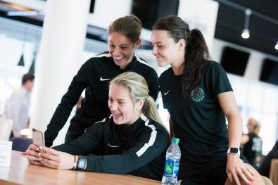 Ashleigh Sykes, Lindsey Horan, and Hayley Raso taking a selfie during 2017 NWSL Media Day. (Monica Simoes)