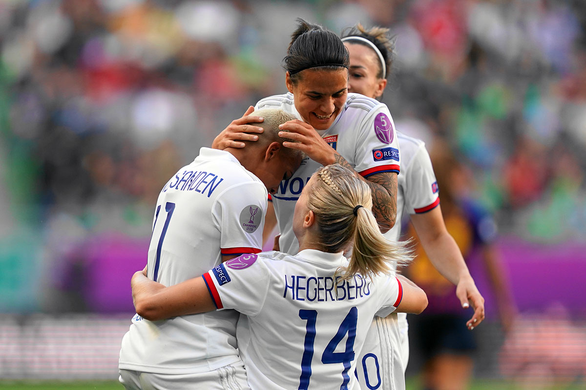 Shanice van de Sanden, Dzsenifer Marozsán, and Ada Hegerberg celebrate during the 2019 UEFA Women's Champions League final. (Daniela Porcelli / OGM)