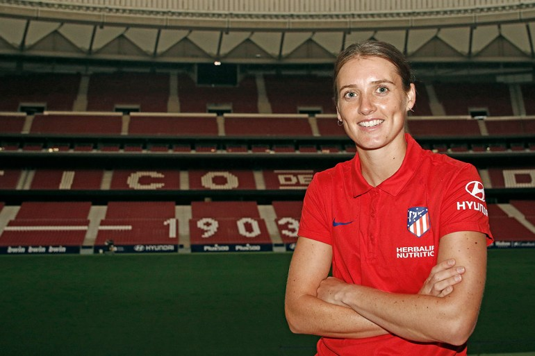 Jade Moore in Atletico Madrid polo shirt with the stadium as a background. (Atletico Madrid)