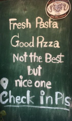 Amusing sign board in Tonsai Bay, Phi Phi Islands