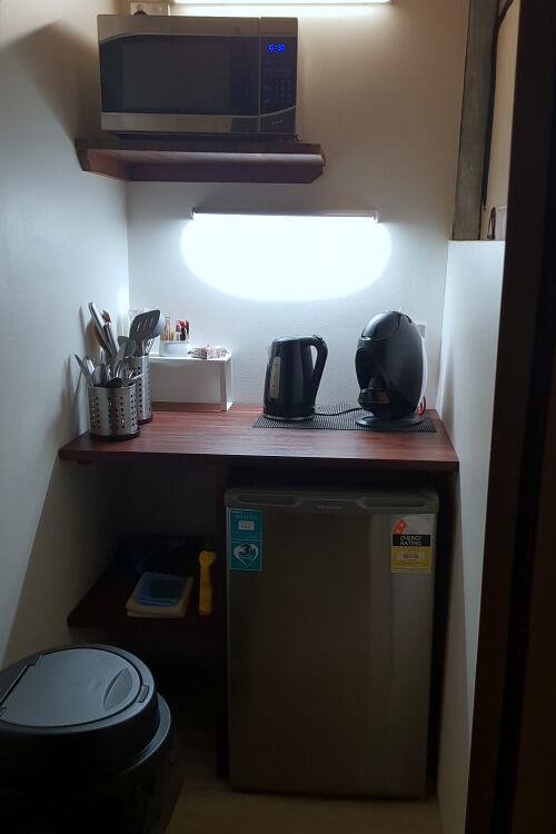 Small kitchenette includes coffee making, fridge and microwave - but no sink