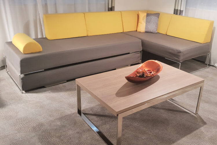 Living room couch that can fold out to a Bed | Novotel World Trade Centre Dubai Family Review
