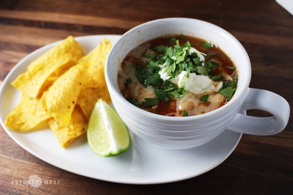 This quick and easy chicken tortilla soup makes a comforting weeknight meal. It has big flavor and gets its mellow heat from a chipotle chile.