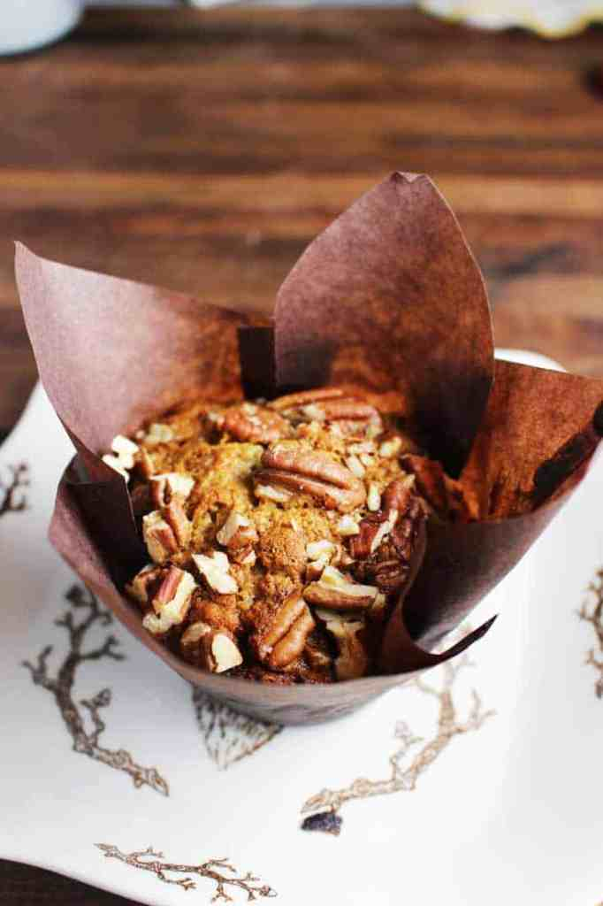 Banana Pecan muffins in brown paper liner, on a plate