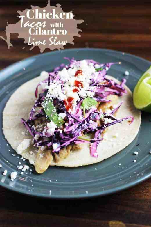 This easy chicken taco recipe is made with shredded cumin lime chicken and a creamy cilantro lime slaw. #chickentacos #tacotuesday #tacos