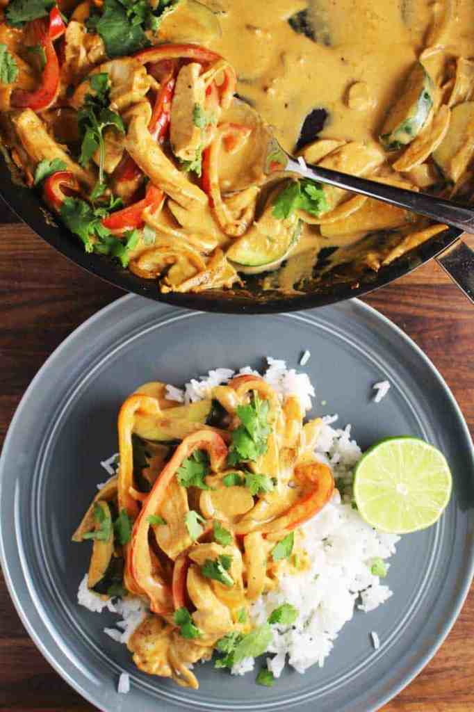 Overhead view of Thai red curry over rice on a plate