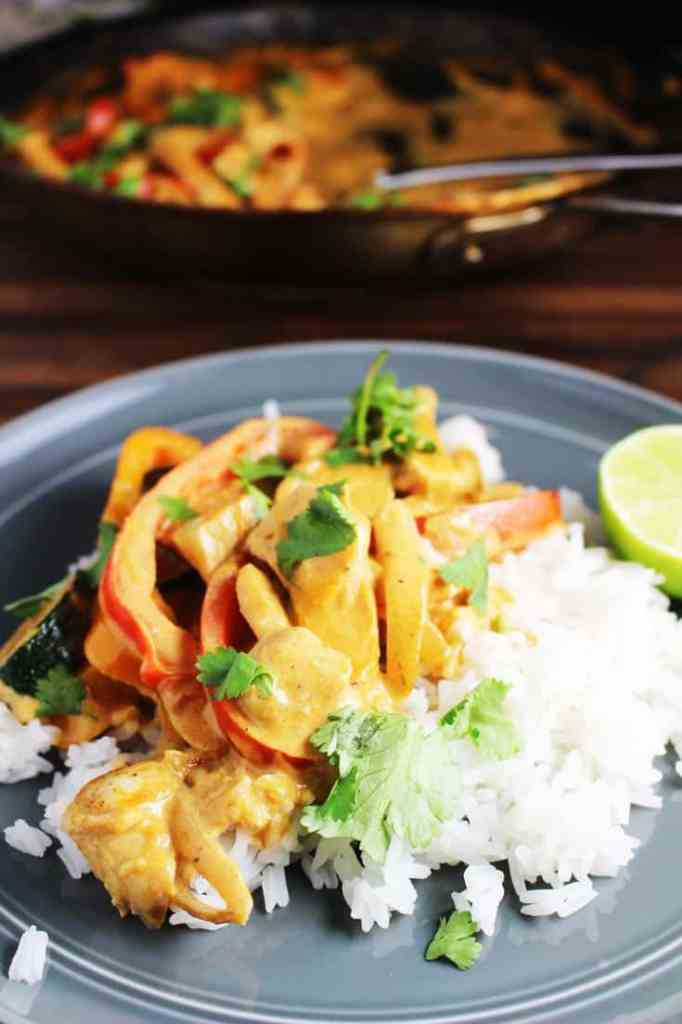 Thai red curry over rice on a plate