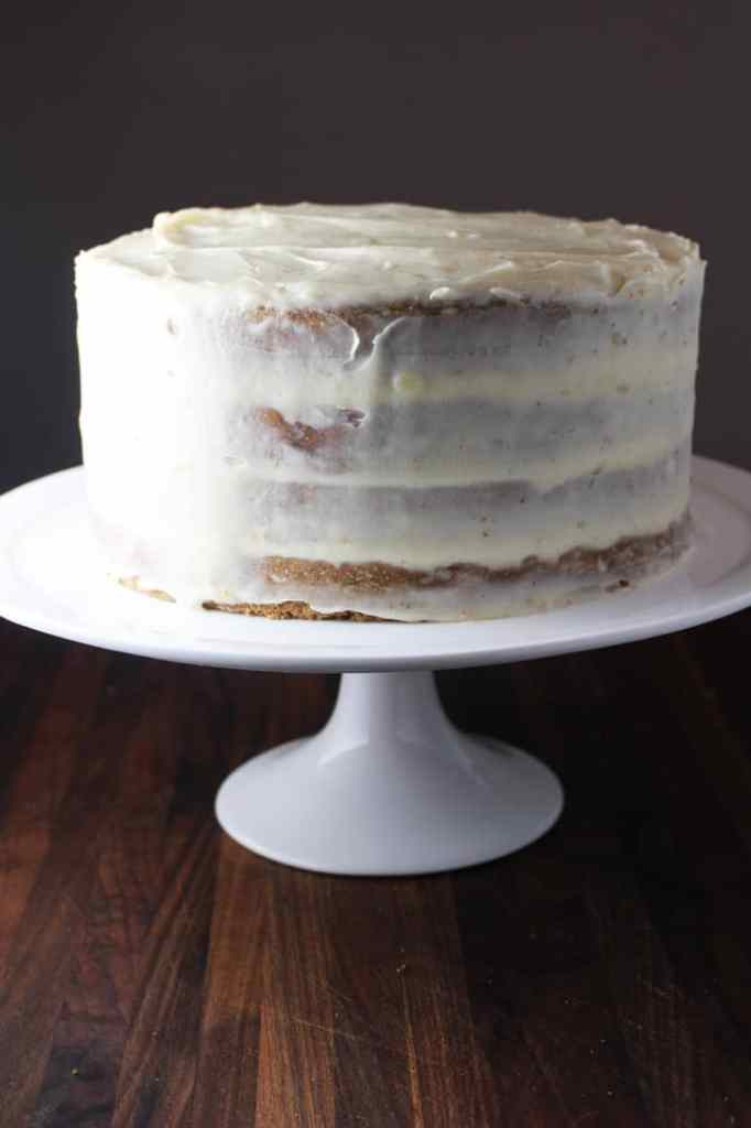Frosted moist carrot cake on a stand