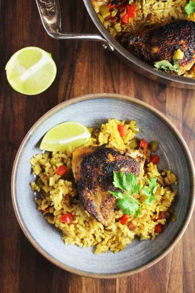 One pot Cuban chicken and rice recipe served in a shallow bowl
