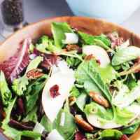 Fall salad with maple dressing in a wooden bowl