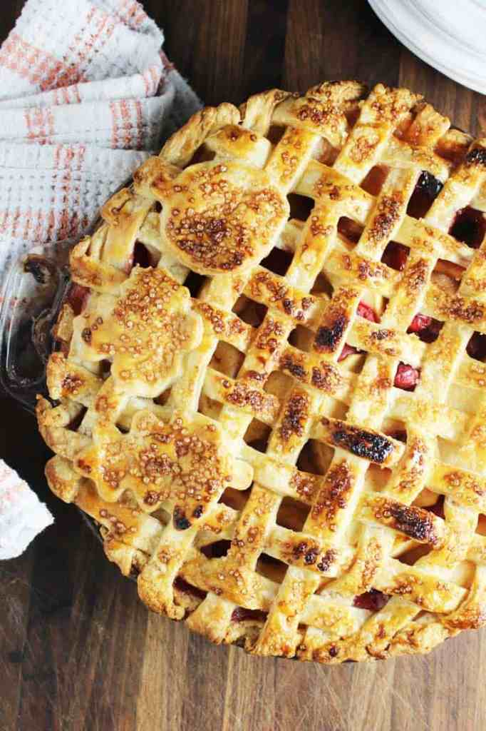 A whole apple cranberry pie with a lattice crust