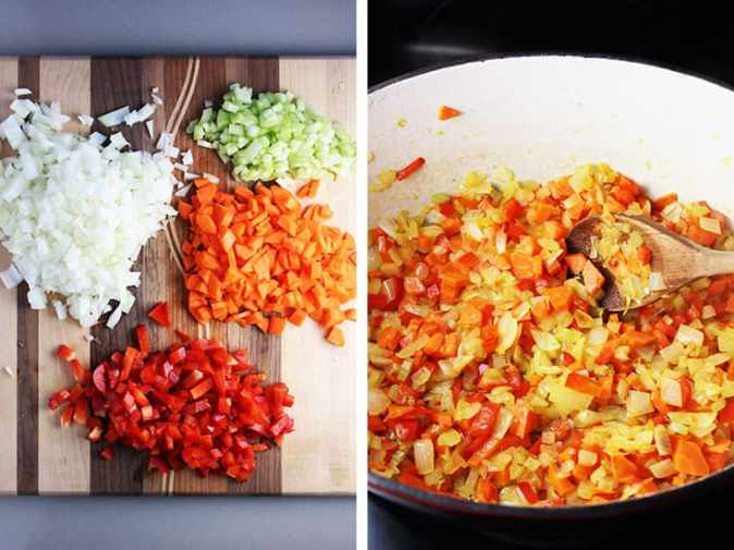 chopped red pepper, onions, carrots and celery on a cutting board, and being cooked in a dutch oven
