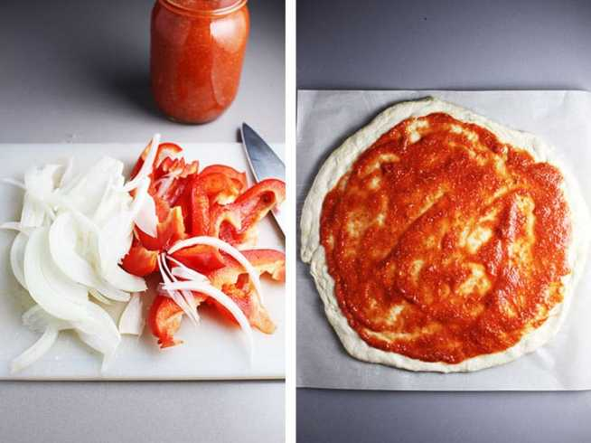 sliced red bell peppers and onions on a cutting board, and pizza dough slathered with pizza sauce