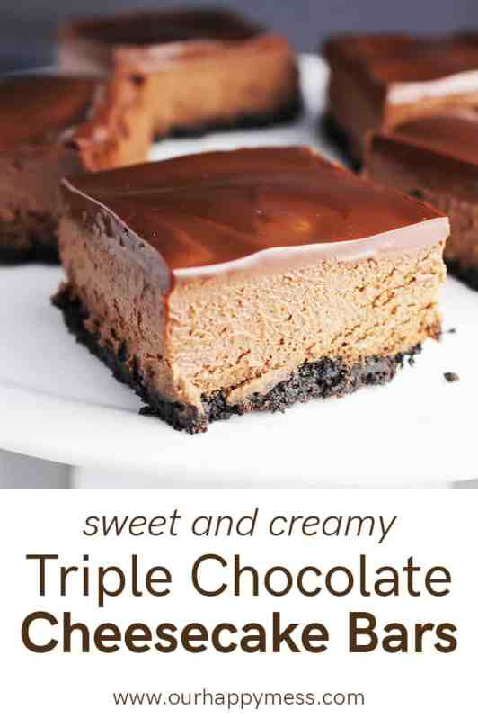 A triple chocolate cheesecake bar on a while plate with more bars in the background
