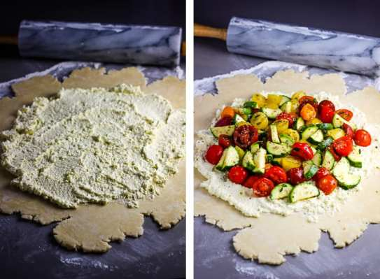 Pie dough rolled out and topped with whipped feta and a tomato zucchini mixture