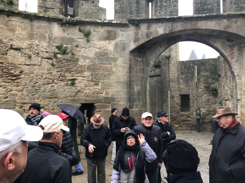 Cevaliers and tour guide during walk along Carcassonne's ramparts Carcassonne Wine Excursions