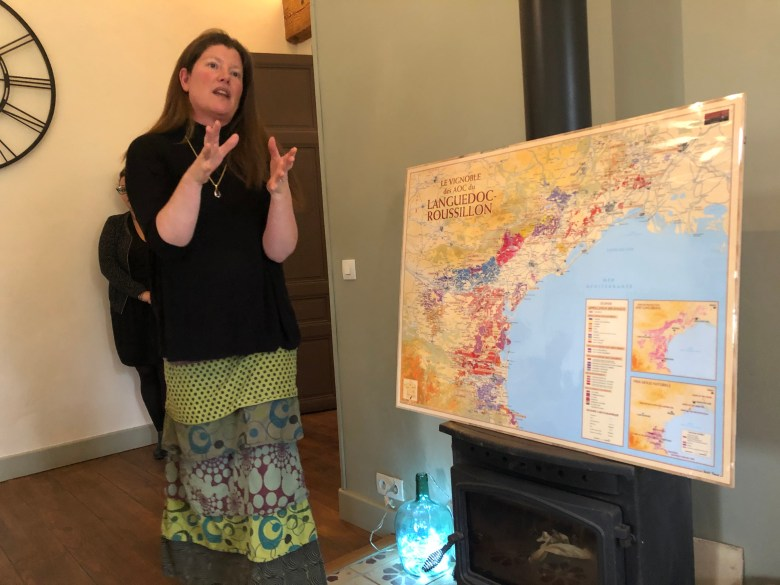 Emma Kershaw teaching with a map of Languedoc-Rousillon Carcassonne Wine Excursions