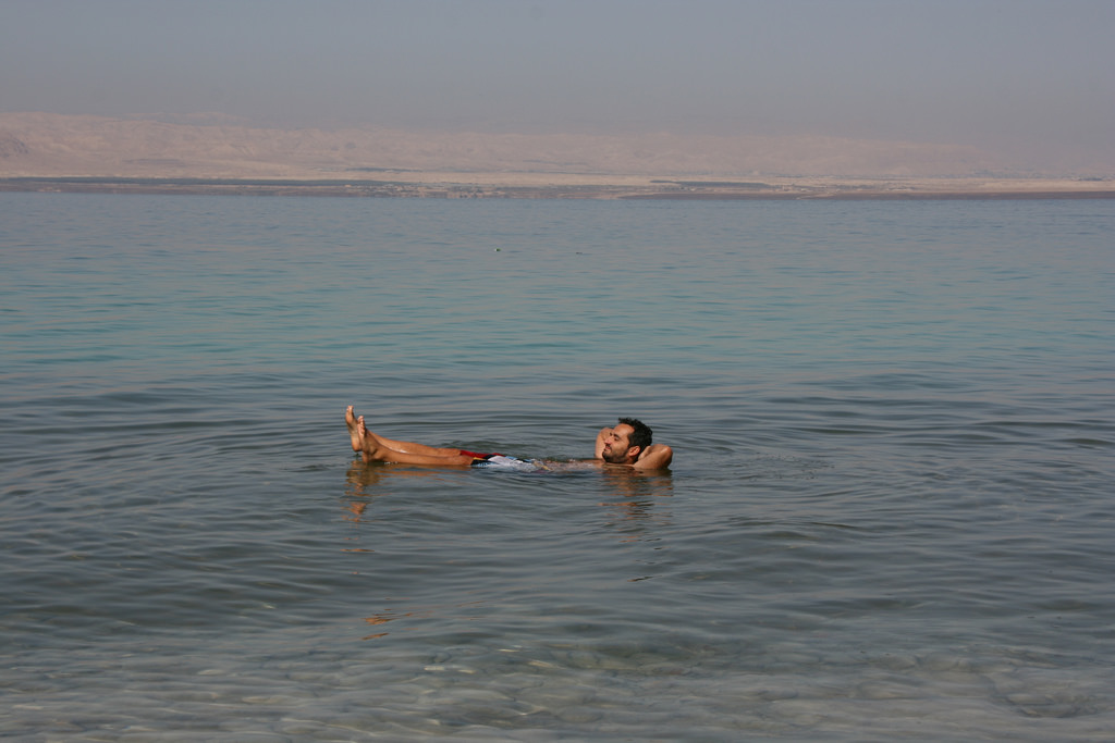 Floating on the Dead Sea literally. Image Credits: Marco Zanferrari on Flickr