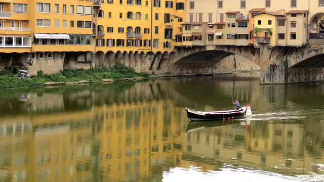 The Arno River flowing through Florence and under the Ponte Vecchio