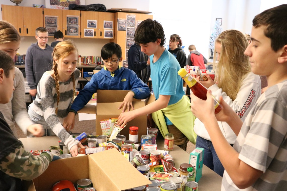 children sorting donated food