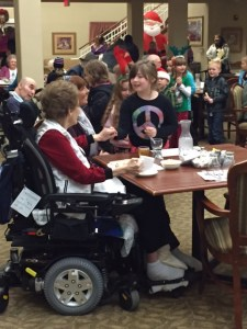 students visiting with the elderly