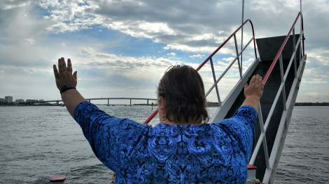 Barb Posing as the Titanic on Lady Dolphin of Daytona