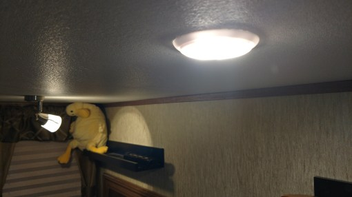 """New LED directional lighting (on left) that replaced the original (on right) """"puck lights"""" that were just spotlights straight down on you in the bed."""