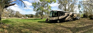 Our Kountry Star and Jeep parked at Golden Acres Goat Ranch, Monticello, Florida - Harvest Hosts