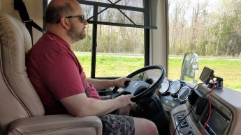 Jason at the helm in our first real travel day with the 2008 Newmar Kountry Star 3916 and the 2016 Jeep Wrangler Background following behind.
