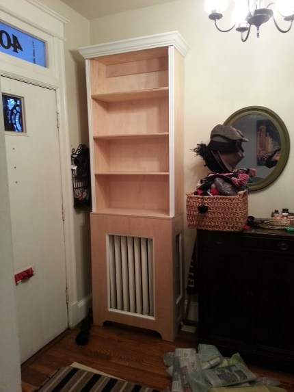 entryway testing out bookshelf radiator cover