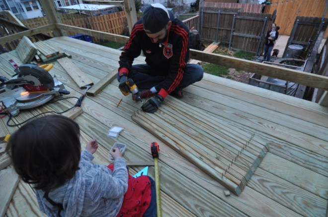 lily helping with back deck balusters