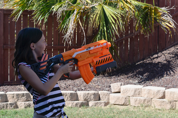 Girl shooting TNerf Machine Gun rocket launcher