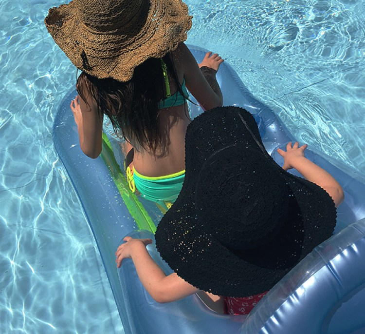 Sun hats in the pool