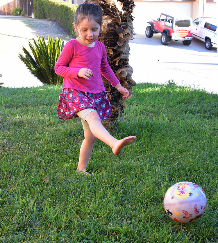Mia 4 year old kicking ball