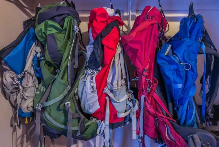 backpacks hanging in a closet