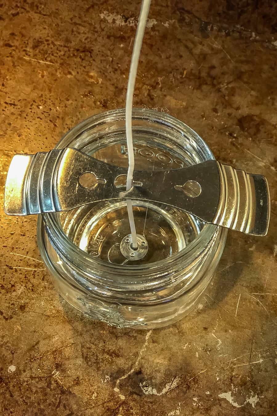 empty mason jar with wick and wick holder