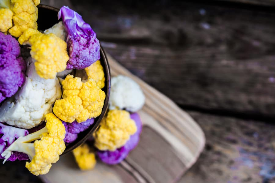 multi colored cauliflower on a wood background