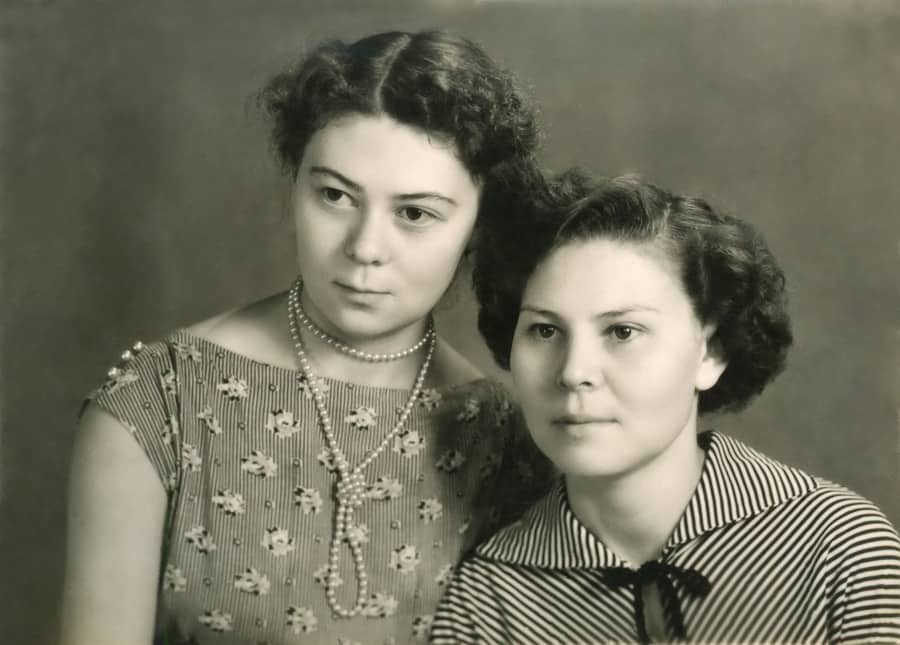a vintage photo of 2 sisters