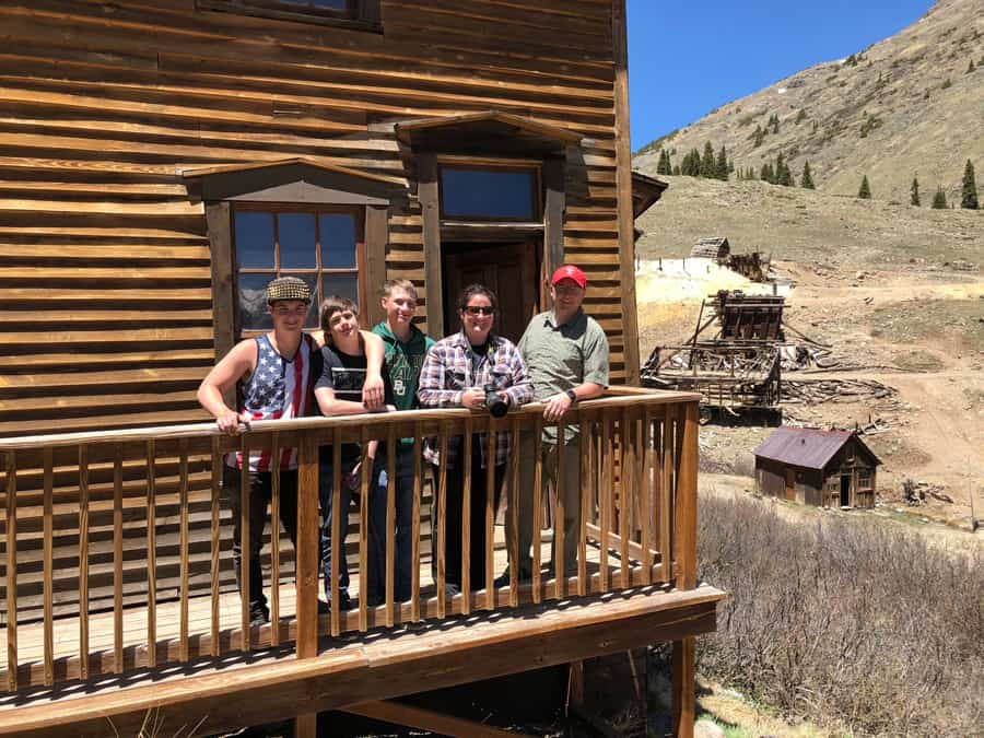 our family on the porch of a ghost town house