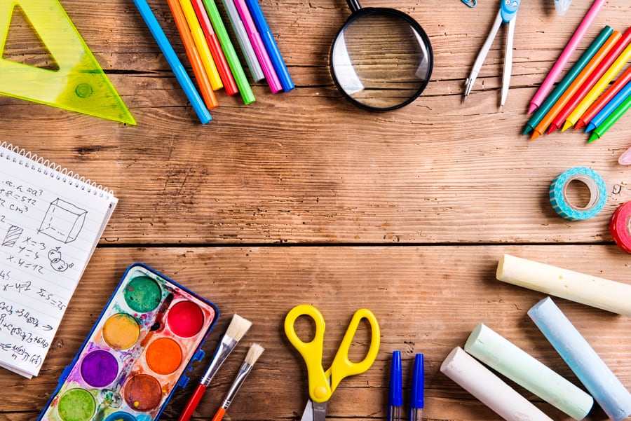flat lay of school supplies on a wooden background