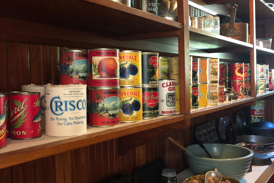 vintage canned goods in a pantry