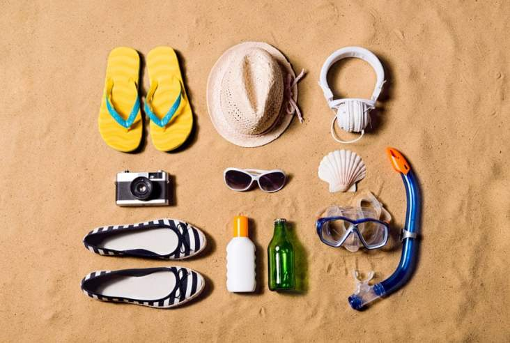 vacation items in the sand