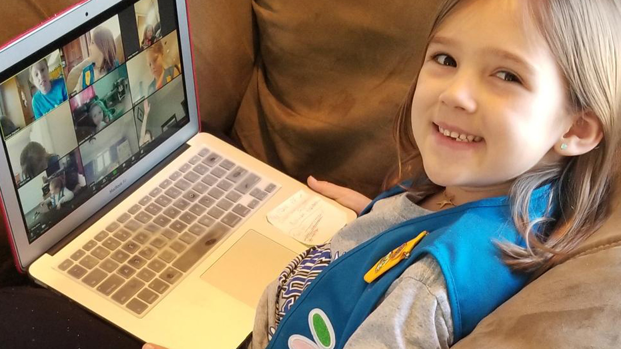 Claire Ruess, from Troop 3790, joins a virtual meeting with her Girl Scout friends. Girl Scouts across the region are staying connected through virtual meetings and programs. (photo: Girl Scouts of Eastern Iowa and Western Illinois)