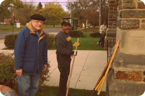 Pastor and Gabe on the parish clean-up and bulb-panting day.